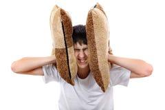 Έφηβος Displeased με το μαξιλάρι Στοκ Εικόνες