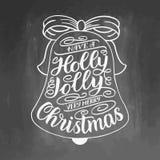 Έχετε τη Χαρούμενα Χριστούγεννα ενός ελαιόπρινου ευχάριστα πολύ Γράφοντας ευχετήρια κάρτα χεριών με το πλαίσιο κάλαντων Χριστουγέ Στοκ Εικόνα