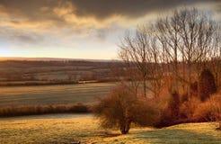 Ήλιος που αυξάνεται πέρα από Gloucestershire Στοκ Εικόνες
