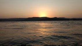 Ήλιος που τίθεται στο φράγμα khadakwasala Στοκ Εικόνα