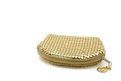 λίγη θηλυκή χρυσή σακούλα στο άσπρο υπόβαθρο Στοκ Φωτογραφία