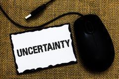 Αβεβαιότητα κειμένων γραφής Έννοια που σημαίνει τη μη προβλεψιμότητα ορισμένο μαύρο pap πινάκων τέχνης ποντικιών συμπεριφοράς USB Στοκ εικόνα με δικαίωμα ελεύθερης χρήσης
