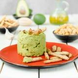Αβοκάντο Hummus με το μίνι grissini, ακόμα ζωή Στοκ Φωτογραφία