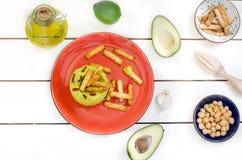 Αβοκάντο Hummus με το μίνι grissini, ακόμα ζωή Στοκ Εικόνα