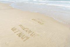 Αγάπη Βιετνάμ ευπρόσδεκτο Βιετνάμ που γράφεται στην άμμο Στοκ Φωτογραφία