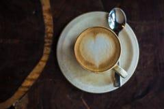 αγάπη εικονογράφων απεικόνισης φλυτζανιών καφέ πλίθας που γίνεται Στοκ Εικόνες