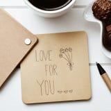 Αγάπη κειμένων για σας σε μια σημείωση Στοκ Εικόνες