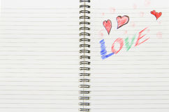 Αγάπη που γράφεται στο σημειωματάριο Στοκ Φωτογραφία