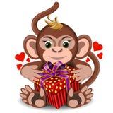 Αγαπήστε τον πίθηκο παιχνιδιών βελούδου με το δώρο κιβωτίων Στοκ φωτογραφία με δικαίωμα ελεύθερης χρήσης