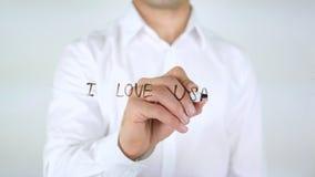 Αγαπώ τις ΗΠΑ, γράψιμο επιχειρηματιών στο γυαλί Στοκ Εικόνες