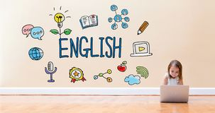 Αγγλικό κείμενο με το μικρό κορίτσι που χρησιμοποιεί έναν φορητό προσωπικό υπολογιστή Στοκ Φωτογραφίες