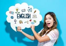 Αγγλικό κείμενο με τη νέα γυναίκα που κρατά μια λεκτική φυσαλίδα στοκ φωτογραφίες