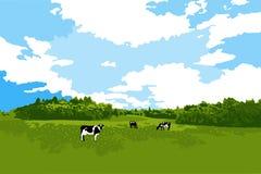Αγελάδες που βόσκουν στο λιβάδι ελεύθερη απεικόνιση δικαιώματος