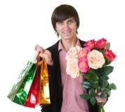 αγορές ατόμων λουλουδιών τσαντών στοκ εικόνα