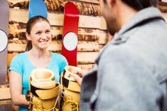 Αγορές για τις μπότες σκι Στοκ εικόνα με δικαίωμα ελεύθερης χρήσης