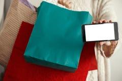 αγορές Χριστουγέννων Διαφήμιση app Ευτυχή τηλεφωνικά WI εκμετάλλευσης κοριτσιών στοκ εικόνες