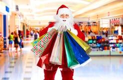 αγορές santa Χριστουγέννων Στοκ εικόνα με δικαίωμα ελεύθερης χρήσης