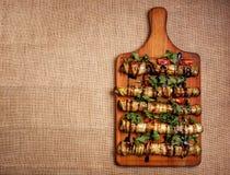 Αγροτικές τηγανισμένες γεμισμένες κολοκύθια και μελιτζάνα Στοκ Εικόνες
