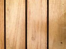 Αγροτικό καφετί ξύλινο υπόβαθρο με τις κάθετες σανίδες στοκ εικόνες