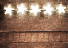 Αγροτικό υπόβαθρο Χριστουγέννων με τα φω'τα και το διάστημα ελεύθερων κειμένων Fes στοκ φωτογραφία με δικαίωμα ελεύθερης χρήσης