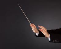 Αγωγός μουσικής με ένα μπαστούνι Στοκ Εικόνες