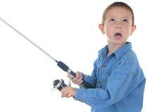 αγόρι αλιεύοντας ένα Στοκ Φωτογραφίες