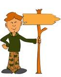 Αγόρι δασοφυλάκων που κρατά ένα σημάδι Στοκ εικόνες με δικαίωμα ελεύθερης χρήσης