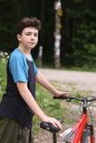 Αγόρι εφήβων με το ποδήλατο Στοκ Εικόνα