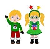 Αγόρι και κορίτσι με το κοστούμι Χριστουγέννων Στοκ φωτογραφία με δικαίωμα ελεύθερης χρήσης