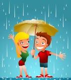 Αγόρι και κορίτσι μια βροχερή ημέρα Στοκ Φωτογραφίες