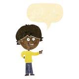 αγόρι κινούμενων σχεδίων που γελά και που δείχνει με τη λεκτική φυσαλίδα Στοκ φωτογραφία με δικαίωμα ελεύθερης χρήσης