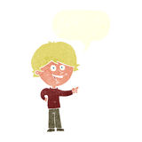αγόρι κινούμενων σχεδίων που γελά και που δείχνει με τη λεκτική φυσαλίδα Στοκ εικόνες με δικαίωμα ελεύθερης χρήσης
