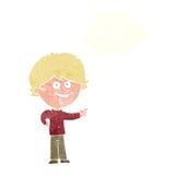 αγόρι κινούμενων σχεδίων που γελά και που δείχνει με τη σκεπτόμενη φυσαλίδα Στοκ Εικόνες