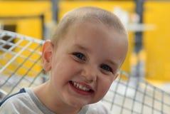 Αγόρι με ένα τυροειδές χαμόγελο Στοκ φωτογραφία με δικαίωμα ελεύθερης χρήσης