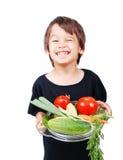 Αγόρι με τα λαχανικά στα χέρια Στοκ Φωτογραφίες