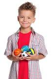 Αγόρι με τις μικρές σφαίρες Στοκ εικόνες με δικαίωμα ελεύθερης χρήσης