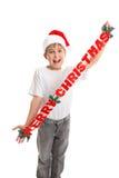 Αγόρι με το έμβλημα Χριστουγέννων στοκ φωτογραφίες