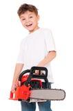 Αγόρι με το αλυσιδοπρίονο Στοκ Εικόνες