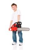 Αγόρι με το αλυσιδοπρίονο Στοκ φωτογραφία με δικαίωμα ελεύθερης χρήσης