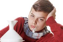 Αγόρι με το θερμόμετρο που προετοιμάζεται για τις διαδικασίες επεξεργασίας Στοκ Φωτογραφίες