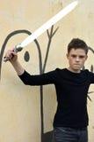 Αγόρι με το ξίφος λέιζερ Στοκ Φωτογραφία