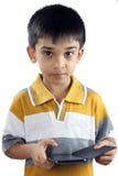 Αγόρι με το τηλέφωνο κυττάρων Στοκ Φωτογραφίες