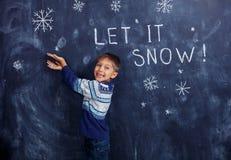 Αγόρι με το χιόνι στο στούντιο Στοκ Εικόνες