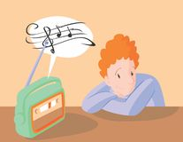 Αγόρι που ακούει τη μουσική στο ραδιόφωνο Στοκ φωτογραφία με δικαίωμα ελεύθερης χρήσης