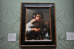 Αγόρι που δαγκώνεται από μια σαύρα από Caravaggio στην εθνική στοά πορτρέτου, Λονδίνο Στοκ Εικόνα