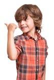Αγόρι που δείχνει το κενό διάστημα Στοκ Εικόνες