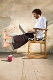 Αγόρι που εργάζεται στο lap-top Στοκ Εικόνες