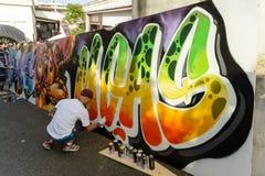 Αγόρι που σύρει ένα γκράφιτι Στοκ Εικόνα