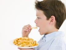 αγόρι που τρώει τις νεολ&al Στοκ εικόνες με δικαίωμα ελεύθερης χρήσης