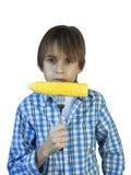Αγόρι που τρώει το καλαμπόκι Στοκ φωτογραφία με δικαίωμα ελεύθερης χρήσης